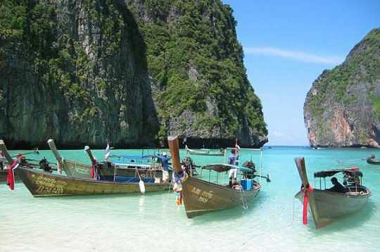 Longtail dive boats in Koh Phi Phi - this'll be a new fun way to reach a dive site!